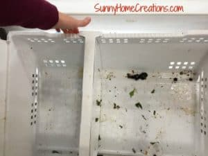 Pulling bottom basket out to clean freezer drawer